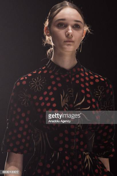 A model presents a creation by ISABEL GARCIA during the 2017/2018 Fall/Winter MercedesBenz Fashion Week Russia on March 13 2017 in Moscow