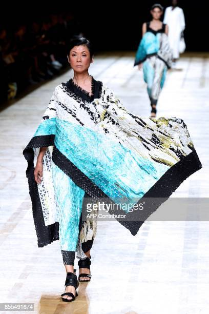 A model presents a creation by Issey Miyake during the women's 2018 Spring/Summer readytowear collection fashion show in Paris on September 29 2017 /...