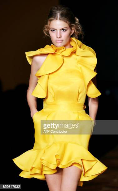 A model presents a creation by Italian designer Stefano Pilati for Yves SaintLaurent Rive Gauche during the SpringSummer 2005 Ready to Wear...