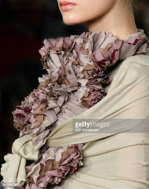 A model presents a creation by Italian designer Stefano Pilati for Yves Saint Laurent during the Spring/Summer 2006 ReadytoWear collections in Paris...