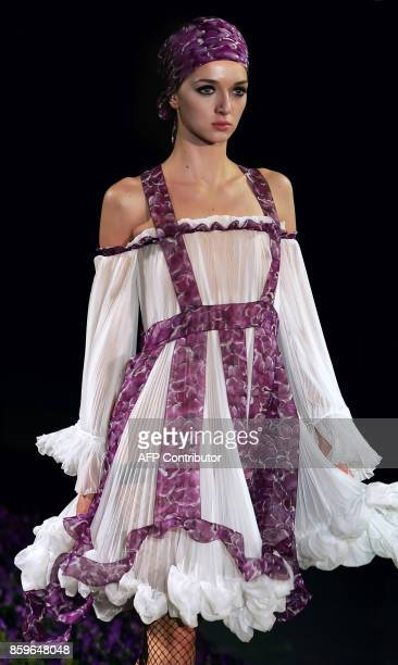 A model presents a creation by Italian designer Stefano Pilati for Yves Saint Laurent during the Spring/Summer 2007 readytowear collections in Paris...