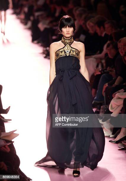 A model presents a creation by Italian designer Stefano Pilati for Yves Saint Laurent during the Autumn/Winter 200607 readytowear collections in...