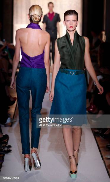 A model presents a creation by Italian designer Stefano Pilati for Yves Saint Laurent during the Spring/Summer 2012 readytowear collection show on...