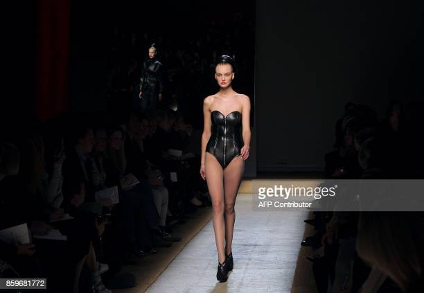 A model presents a creation by Italian designer Stefano Pilati for Yves Saint Laurent during the autumn/winter 2009 readytowear collection show in...
