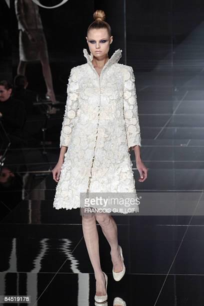 A model presents a creation by Italian designers Maria Grazia Chiuri and Pier Paolo Piccioli for Valentino during a Spring/Summer 2009 Haute Couture...