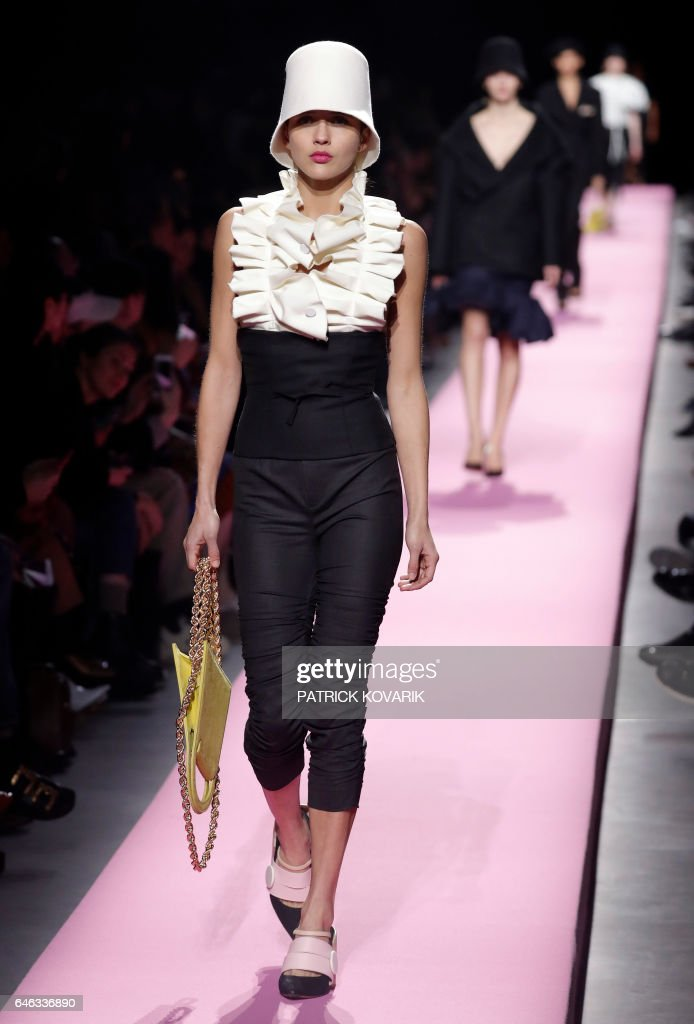 model-presents-a-creation-by-jacquemus-during-the-womens-fallwinter-picture-id646336890