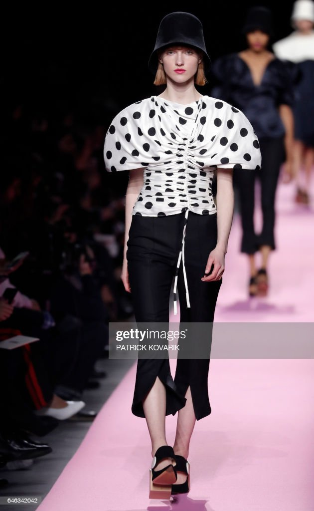model-presents-a-creation-by-jacquemus-during-the-womens-fallwinter-picture-id646342042