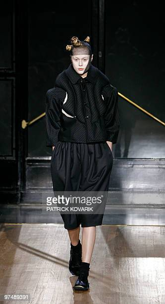 A model presents a creation by Japanese designer Rei Kawakubo for Comme des Garcons during the autumnwinter 2010/2011 readytowear collection show on...