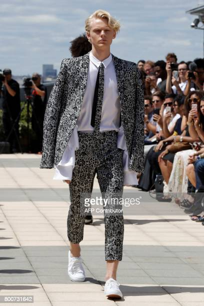 A model presents a creation by Japanese fashion designer Rynshu during the Men's Fashion Week for the Spring and Summer 2018 collection in Paris on...
