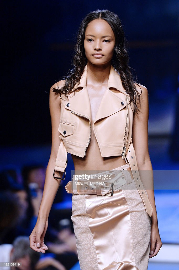 A model presents a creation by Jean Paul Gaultier during the 2014 Spring/Summer ready-to-wear collection fashion show, on September 28, 2013 in Paris.