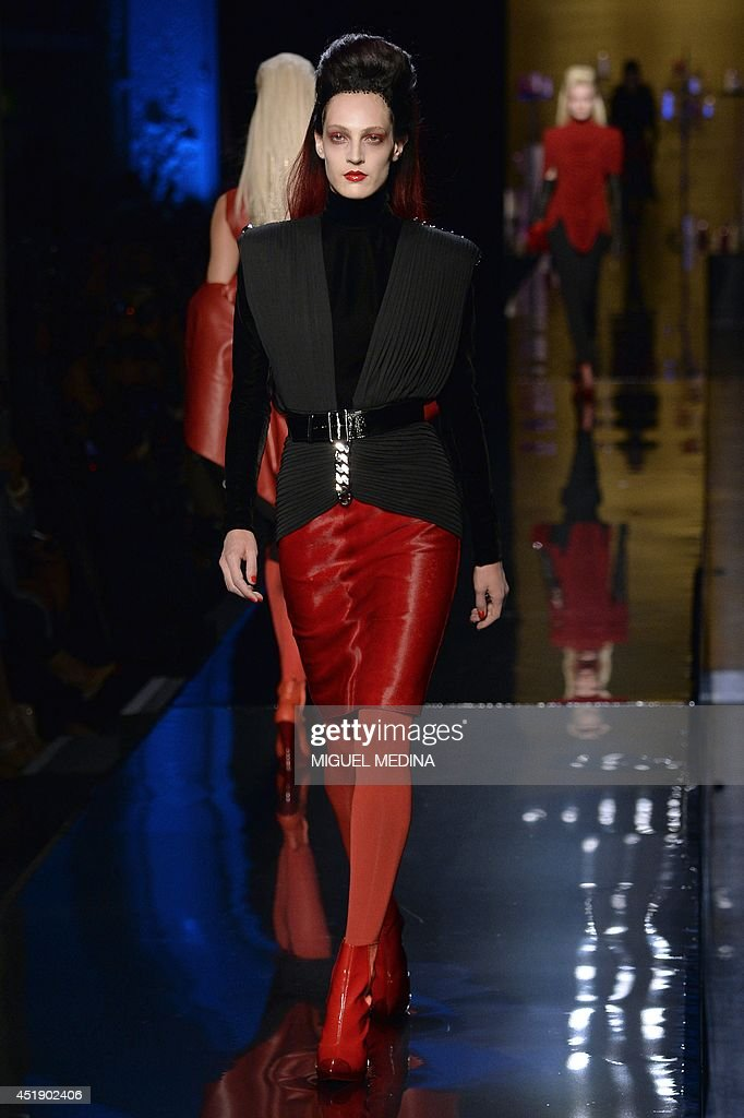 A model presents a creation by Jean Paul Gaultier during the 2014/2015 Haute Couture Fall-Winter collection fashion show on July 9, 2014 in Paris.