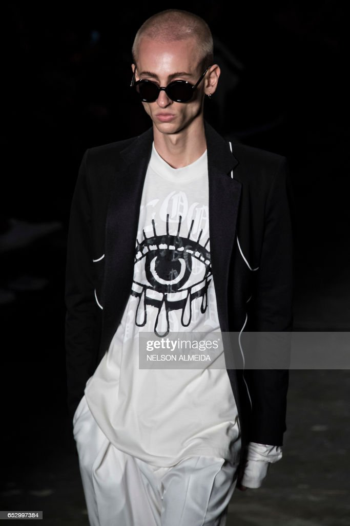 A model presents a creation by Joao Pimenta during the Sao Paulo Fashion Week in Sao Paulo, Brazil on March 13, 2017