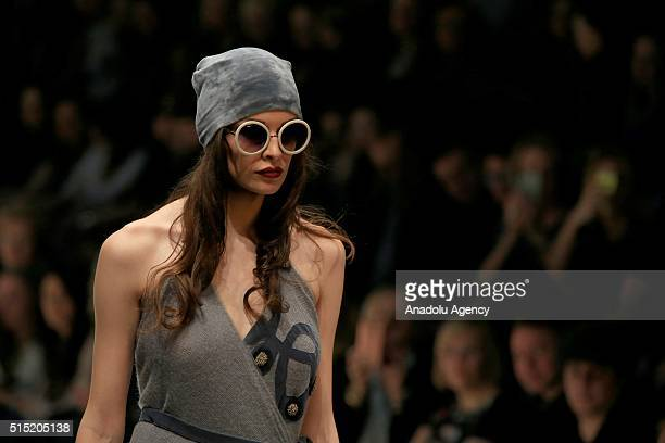 A model presents a creation by Julia Dalakian during the 2016/2017 Fall/Winter MercedesBenz Fashion Week Russia in Moscow on March 12 2016