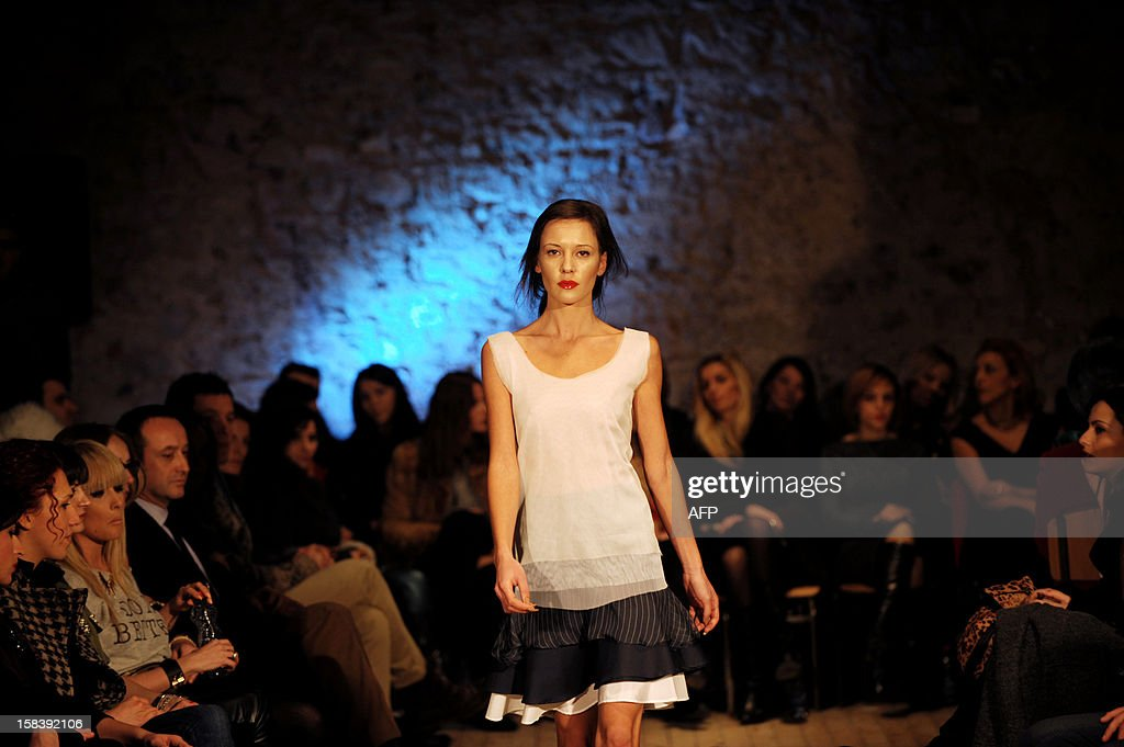 A model presents a creation by Kosovar designer Krenare Rugova during a spring/summer collection fashion show in Pristina late on December 14, 2012.