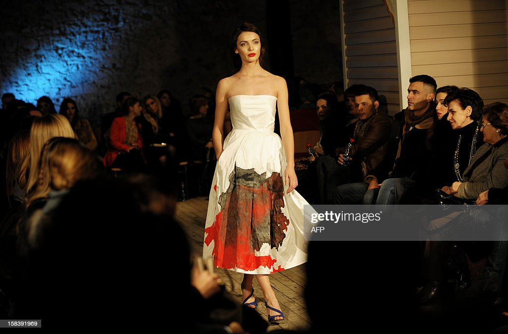 A model presents a creation by Kosovar designer Krenare Rugova during the Spring/Summer collection fashion shows in Pristina late December 14, 2012.