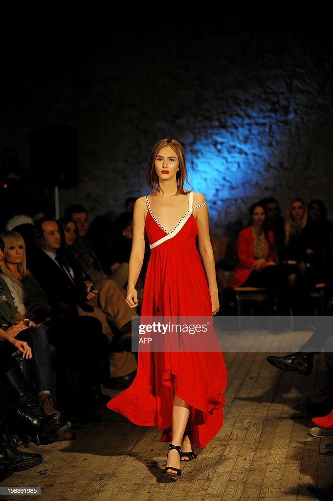 A model presents a creation by Kosovar designer Krenare Rugova during the Spring/Summer collection shows in Pristina late December 14, 2012.