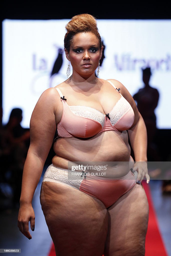 A model presents a creation by 'La belle affranchie' during the first Pulp fashion week, on October 27, 2013 in Paris. AFP PHOTO / FRANCOIS GUILLOT