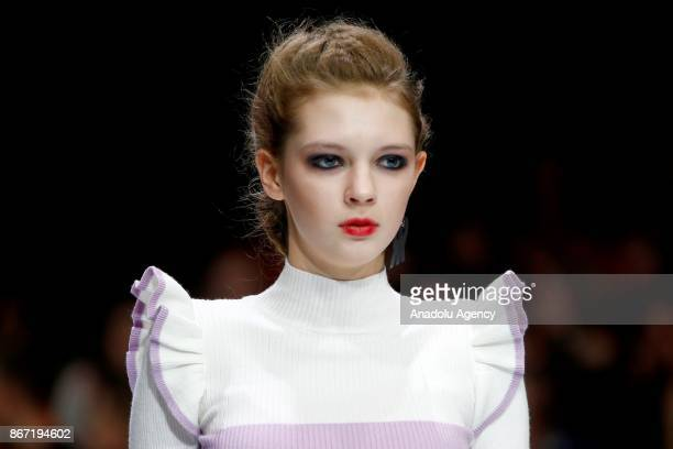 A model presents a creation by La Redoute during the Moscow Fashion Week in Moscow Russia on October 27 2017