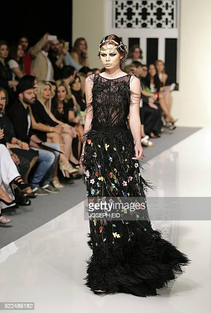 A model presents a creation by Lebanese Designer Shady Zeineldine from his 'A Beryth 2016' collection during 'La Mode a Beyrouth' fashion week in the...