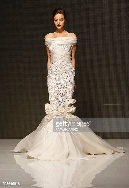 A model presents a creation by Lebanese fashion designer Dany Atrache Haute Couture collection during the 'La Mode a Beyrouth' fashion week in the...