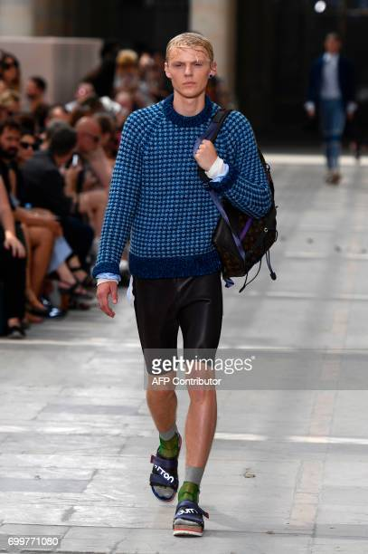 A model presents a creation by Louis Vuitton during the Men's Fashion Week for the Spring and Summer 2018 collection in Paris on June 22 2017 / AFP...