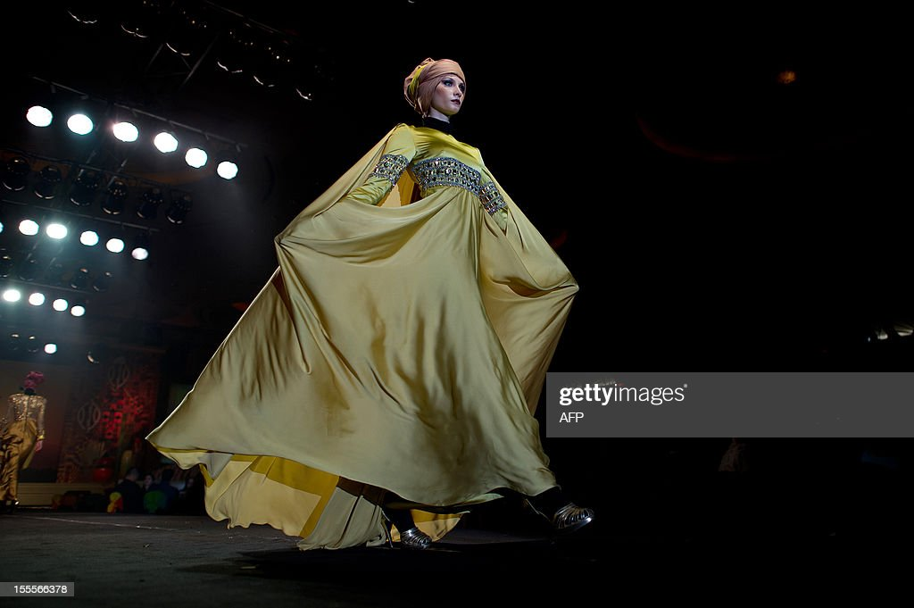 A model presents a creation by Malaysian designer Syaiful Baharim on November 5, 2012, during the Islamic Fashion Festival in Kuala Lumpur. AFP PHOTO / MOHD RASFAN