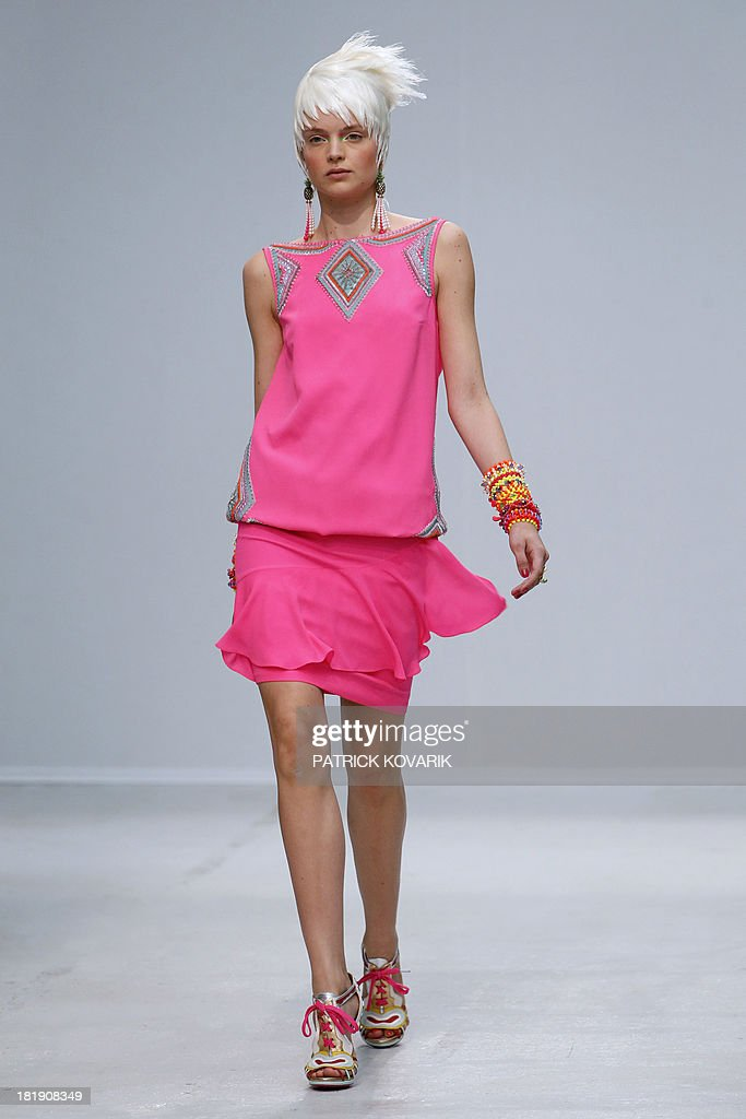 A model presents a creation by Manish Arora during the 2014 Spring/Summer ready-to-wear collection fashion show, on September 26, 2013 in Paris.