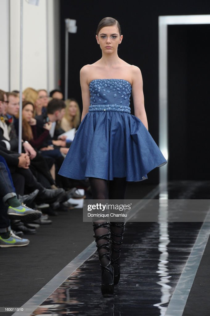 A model presents a creation by Maxime Simoens Fall/Winter 2013 Ready-to-Wear show as part of Paris Fashion Week on March 3, 2013 in Paris, France.