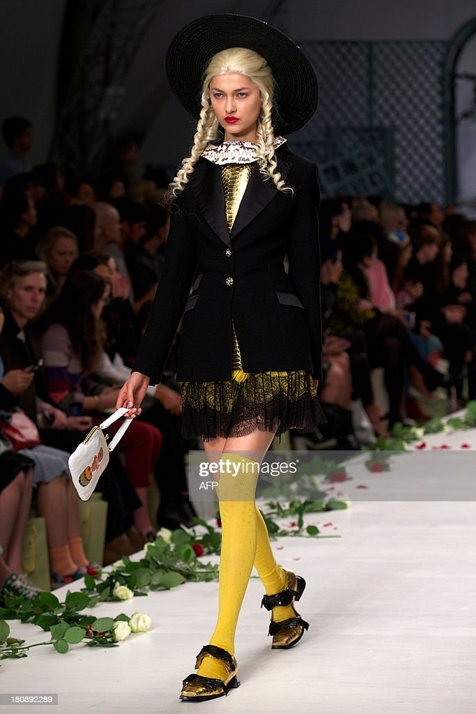 A model presents a creation by Meadham Kirchhoff during the 2014 Spring/Summer London Fashion Week in London on September 17, 2013. AFP PHOTO / ANDREW COWIE