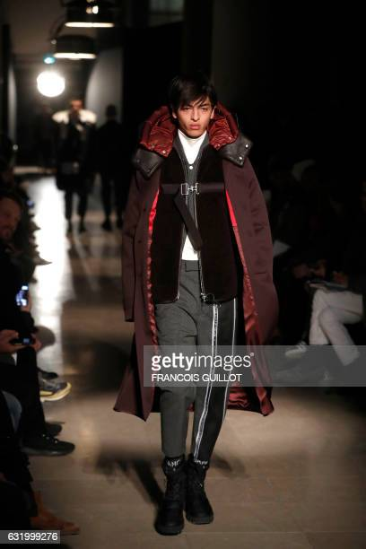 A model presents a creation by OAMC during men's Fashion Week for the Fall/Winter 2017/2018 collection in Paris on January 18 2017 / AFP / FRANCOIS...