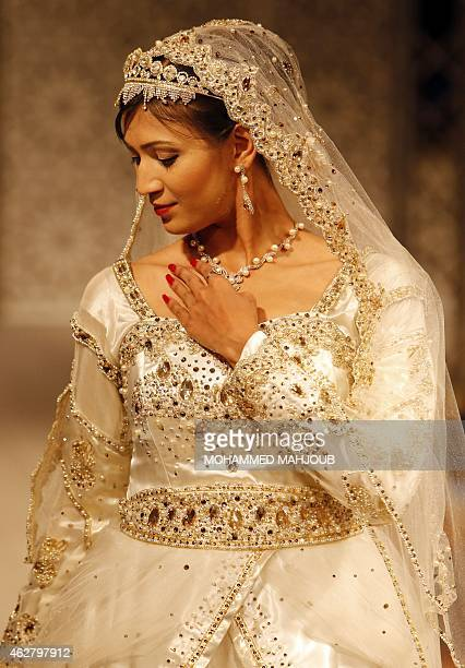 A model presents a creation by Omani designer Hana alOheibeh during a fashion show organised as part ot the Muscat Festival on February 5 2015 in the...