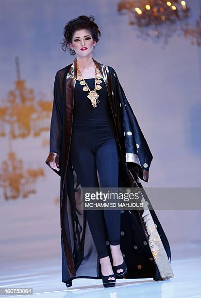 A model presents a creation by Omani fashion designer Reem alalawi during the Gulf's Forum of Elegance event on December 21 2014 in the Omani capital...