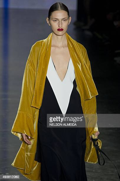 A model presents a creation by Osklen during the 2016 Winter collection of the Sao Paulo Fashion Week in Sao Paulo Brazil on October 22 2015 AFP...