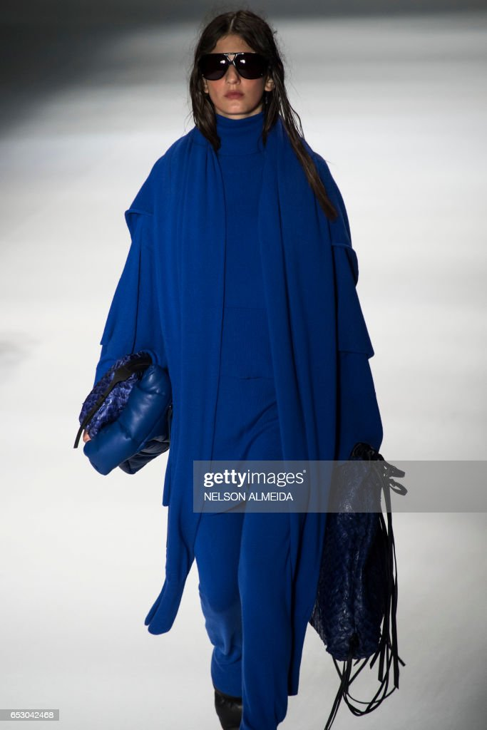 A model presents a creation by Osklen during the Sao Paulo Fashion Week in Sao Paulo, Brazil on March 13, 2017. /