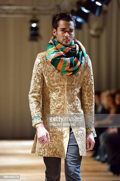 A model presents a creation by Pakistani designer Munib Nawaz on October 31 in Paris AFP PHOTO / ERIC FEFERBERG