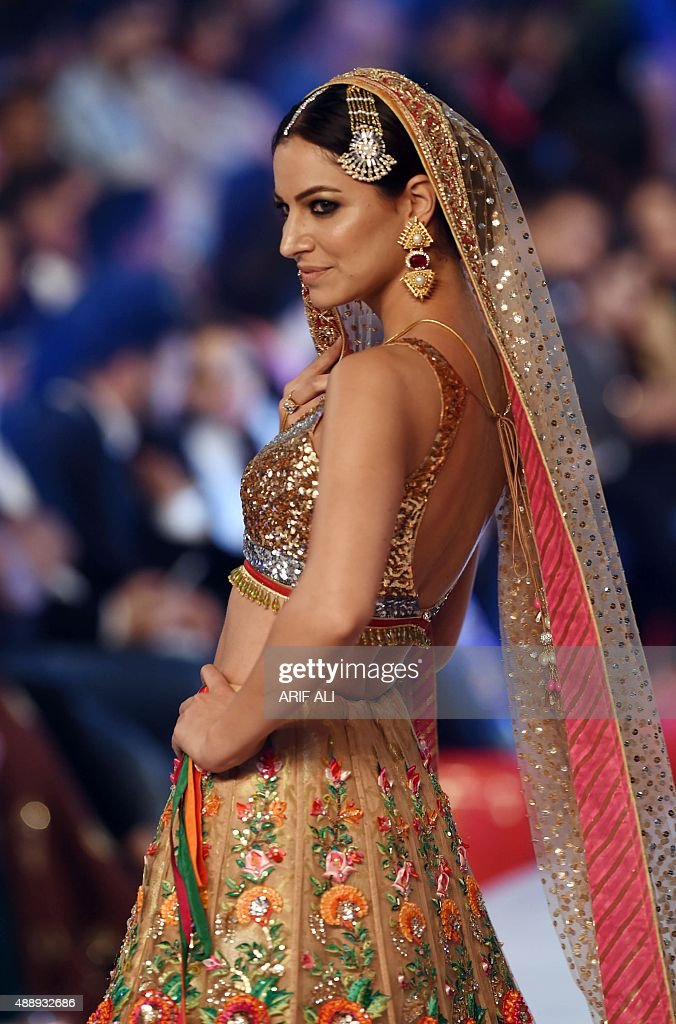 A model presents a creation by Pakistani designer Nomi Ansari on the final day of the Pakistan Fashion Design Council L'Oreal Paris Bridal Week in...