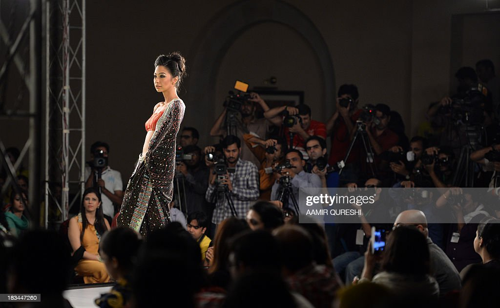 A model presents a creation by Pakistani designer Usman Dittu on the last day of the Islamabad Fashion Week in Islamabad on October 6, 2013. The fashion week's primary objective is to educate, empower and encourage designers and promote traditional crafts.
