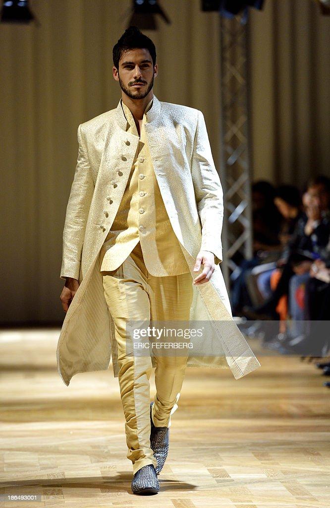 A model presents a creation by Pakistani fashion designer Kamiar Rokni during the Paris-Lahore-Karachi fashion show on October 30, 2013 in Paris.