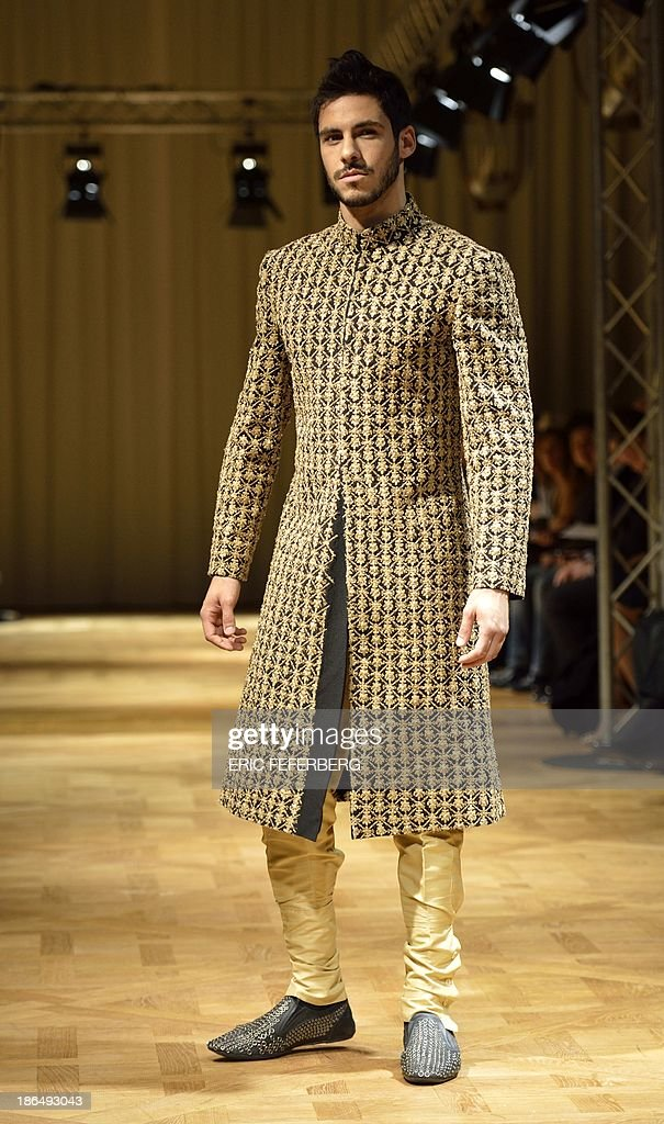 A model presents a creation by Pakistani fashion designer Mohsin Ali during the Paris-Lahore-Karachi fashion show on October 30, 2013 in Paris.