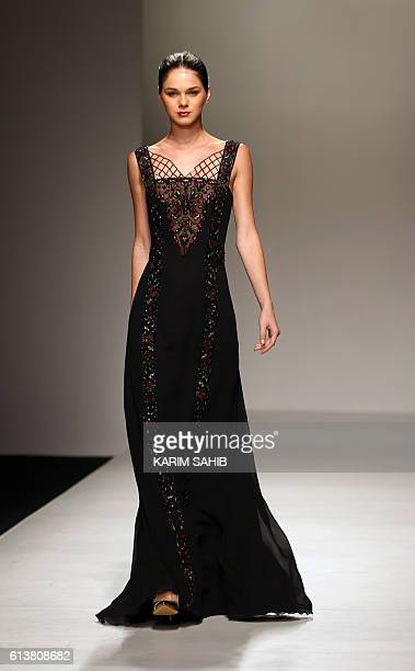 A model presents a creation by Palestinian designer Jamal Taslaq during the Arab Fashion Week in the United Arab Emirate of Dubai on October 10 2016...
