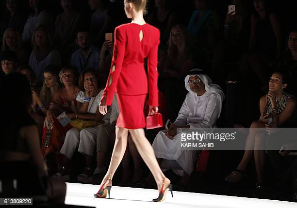 TOPSHOT A model presents a creation by Palestinian designer Jamal Taslaq during the Arab Fashion Week in the United Arab Emirate of Dubai on October...