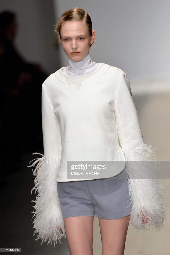 A model presents a creation by Pascal Millet during the 2014 Autumn/Winter ready-to-wear collection fashion show, on February 25, 2014 in Paris.