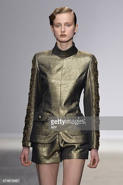 A model presents a creation by Pascal Millet during the 2014 Autumn/Winter readytowear collection fashion show on February 25 2014 in Paris AFP PHOTO...