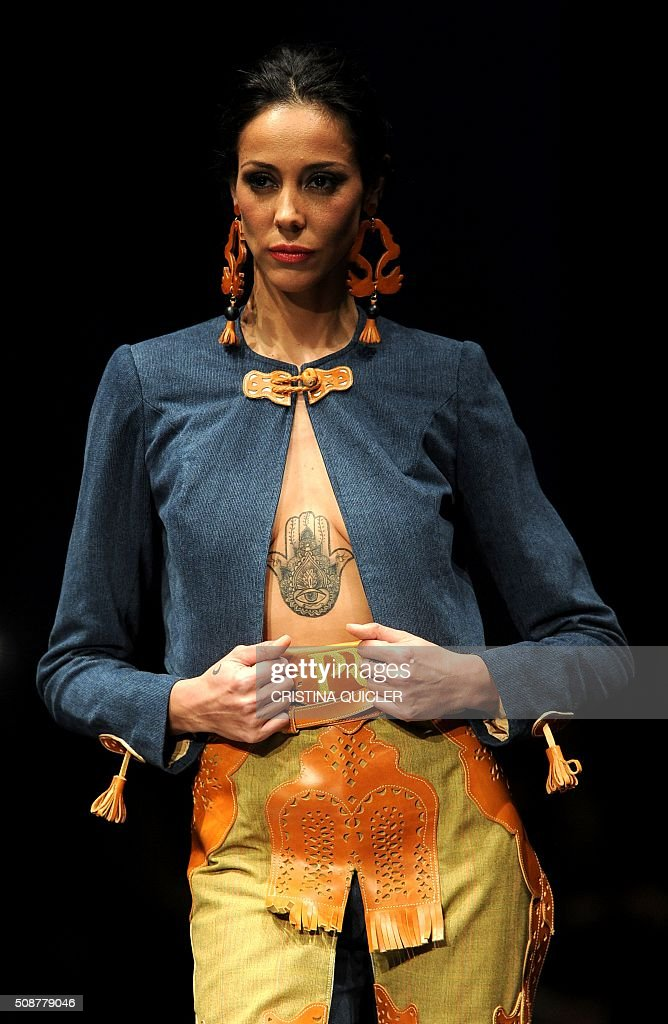 A model presents a creation by Pilar Rubio during the SIMOF 2016 (International Flamenco Fashion Show) in Sevilla, on February 6, 2016. AFP PHOTO/ CRISTINA QUICLER / AFP / CRISTINA QUICLER