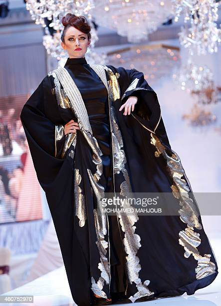 A model presents a creation by Saudi Arabia fashion designer Umaymah Azouz during the Gulf's Forum of Elegance event on December 21 2014 in the Omani...