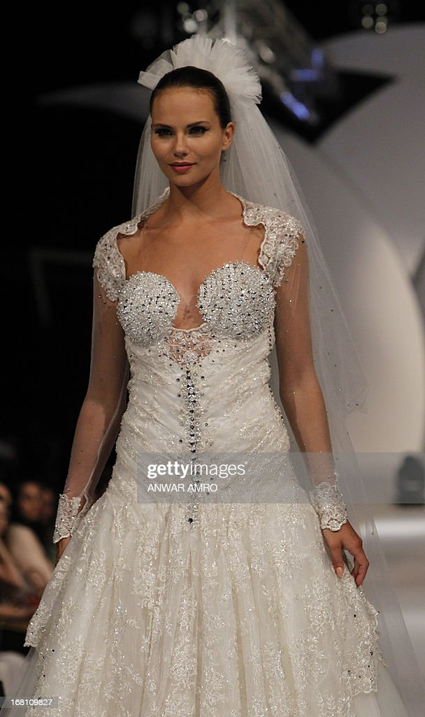 A model presents a creation by Saudi designer Elham Elyoussef during a fashion show in Beirut on May 5, 2013.