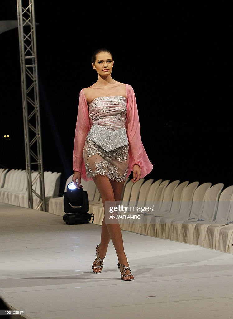 A model presents a creation by Saudi designer Elham Elyoussef during a fashion show in Beirut on May 5, 2013. AFP PHOTO/ANWAR AMRO