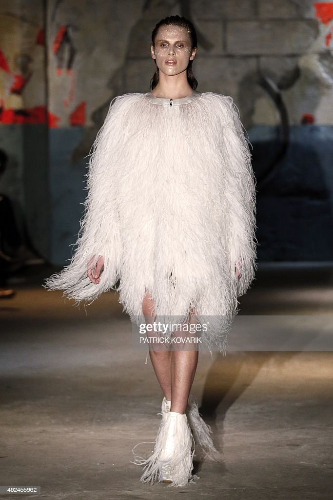 A model presents a creation by Serkan Cura during the 2015 Haute Couture SpringSummer collection fashion show on January 29 2015 in Paris AFP PHOTO /...