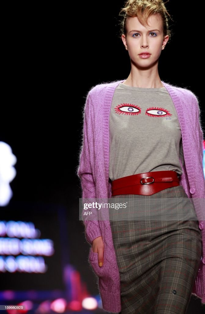 A model presents a creation by Spijkers en Spijkers during the 18th Amsterdam Fashion Week in Amsterdam, The Netherlands, on January24, 2013. The Fashion Week runs from 18 to 27 January. AFP PHOTO/ADE JOHNSON netherlands out