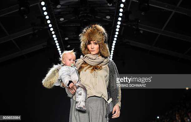 TOPSHOT A model presents a creation by Sportalm at the Berlin Fashion week on January 19 2016 / AFP / TOBIAS SCHWARZ